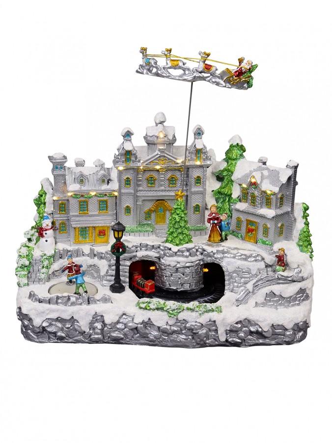 Illuminated & Animated Flying Santa Above Detailed Town Scene - 37cm