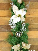 Decorated White Poinsettia, Mistletoe, Berries & Baubles Pine Garland - 2.3m