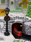 Flying Santa & Reindeer Over Snowy Winter Christmas Village Scene - 38cm